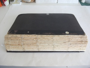 Text block after spine removed but before repair